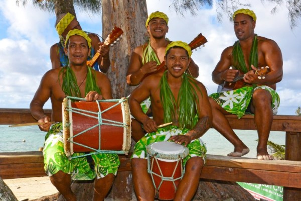 Koka Lagoon Cruises, staff men play ukelele to entertain guests