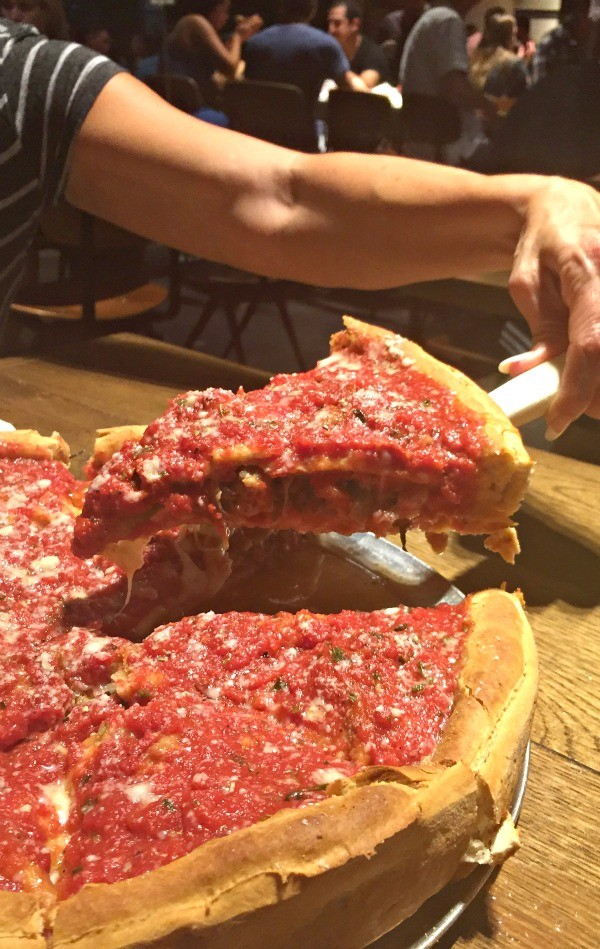 Slice of Chicago Style Deep Dish Pizza from Regents Pizzeria, San Diego