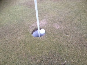 ball wedged on flagstick, penalties