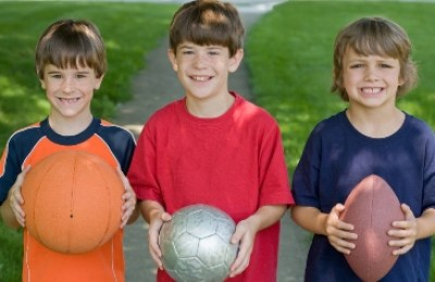Boys with basketball, soccer ball and football