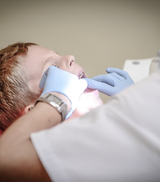 child with dentist