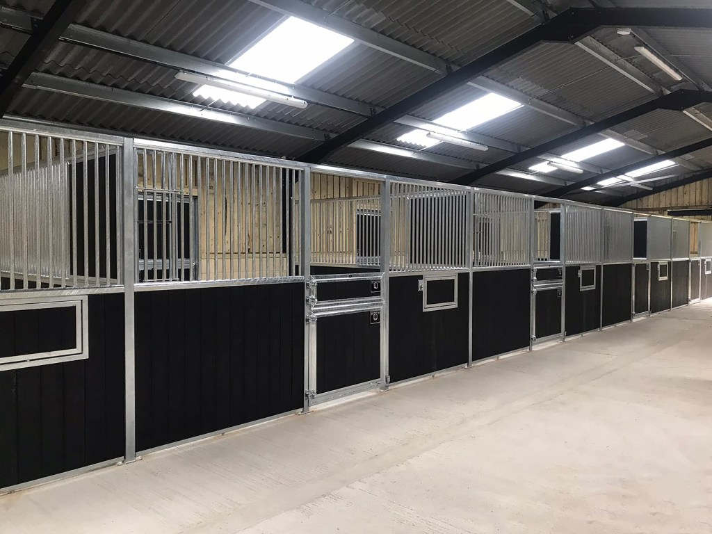 Imperial Stables with Split Pony Doors and Swivel Mangers, in Recycled Black Plastic By Monarch Equestrian