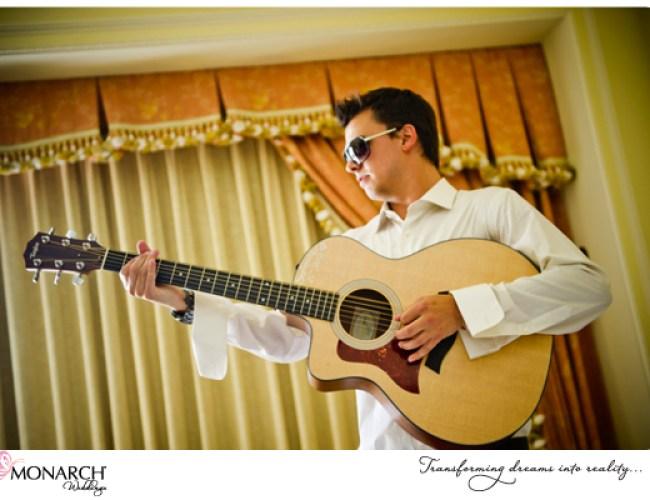 Groomsmen-with-guitar-Westgate-hotel