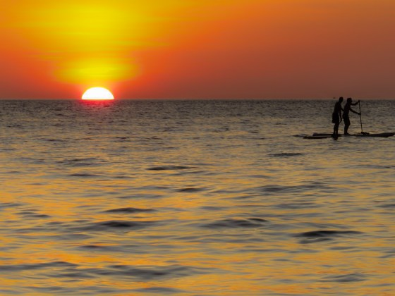 Sunset and stand-up paddling in Thailand