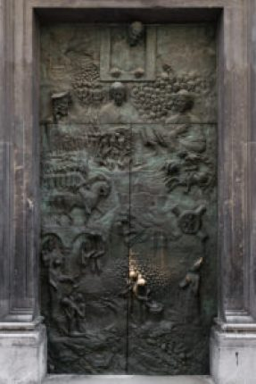 door of Ljubljana Church telling the history of the city