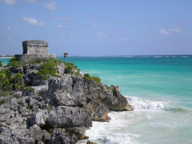 Tulum temple overlooking the sea of the Mexican Caribbean