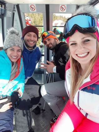 Four of us on a cable car going up the mountain