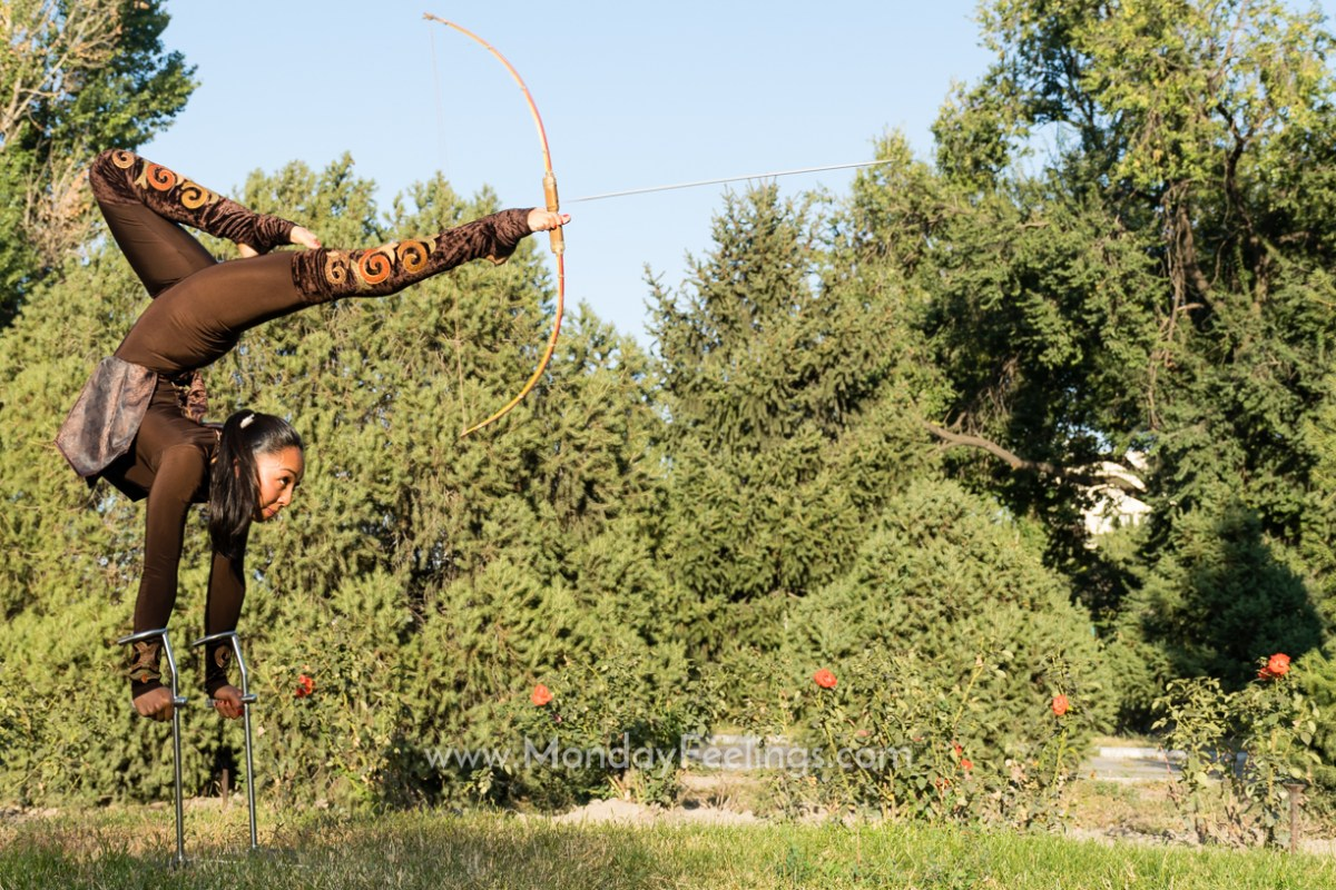 Aida Akmatova performing upside down archery at the World Nomad Games