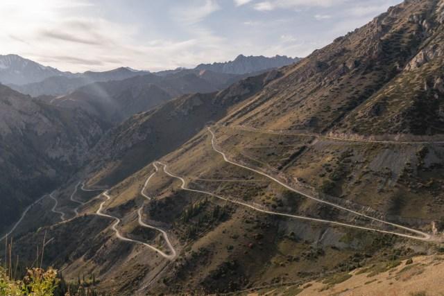 Roads zig zaging a mountain in Kyrgyzstan