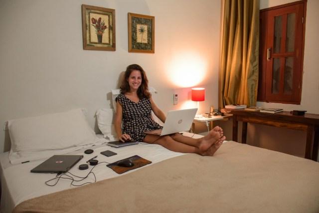 Fe working in the bed of the Flor de Debora Inn