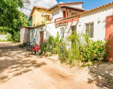 dirty road at the entrance of Flor de Debora Inn in Sao Jorge