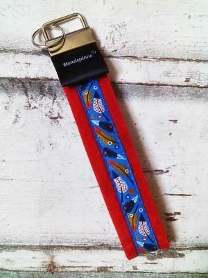 """Schlüsselband """"Federn"""" (rot) von Mondspinne"""