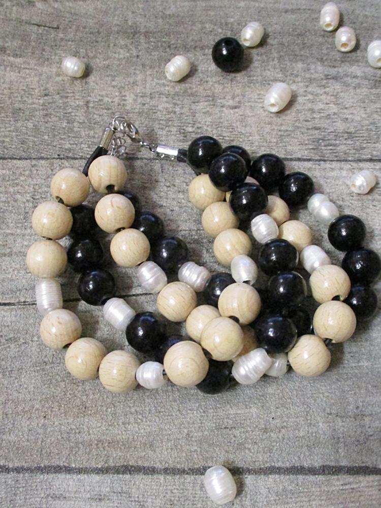 Armband schwarz natur vierreihig Holz Perlen Leder Karabinerverschluss - MONDSPINNE
