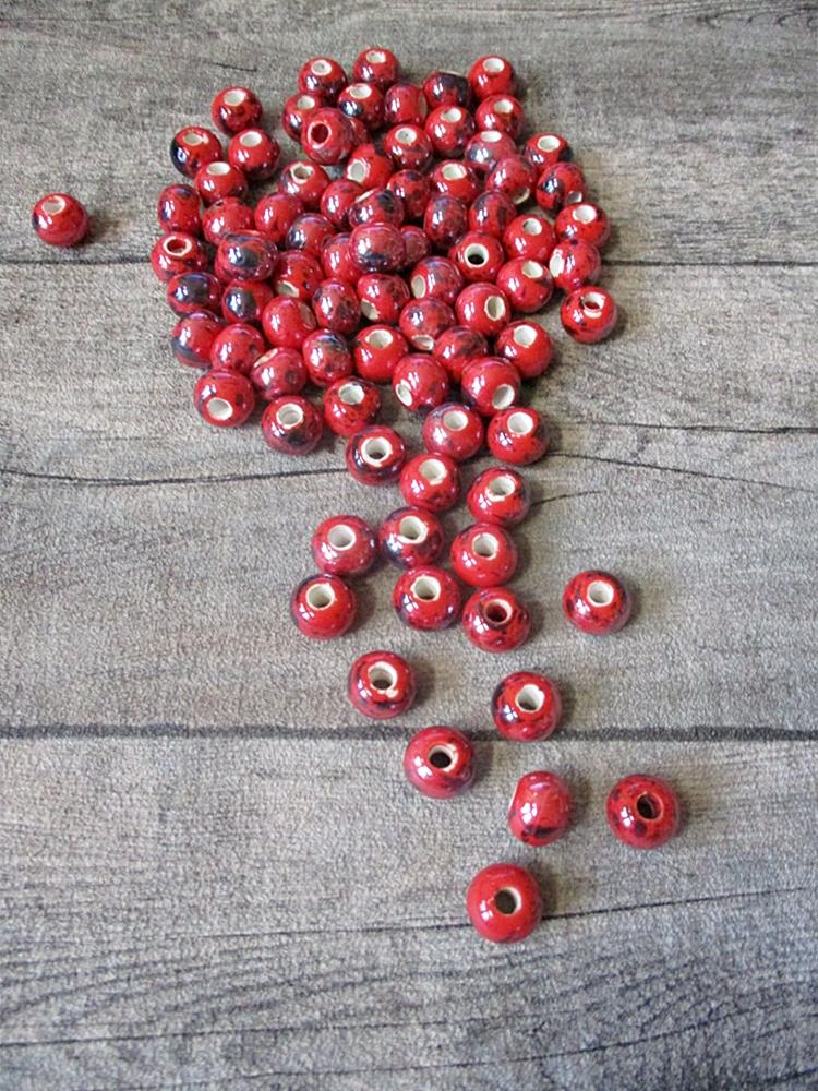 Porzellanperlen Großlochperlen handgefertigt rot perlig 12x9 mm Lochgröße 4 mm - MONDSPINNE