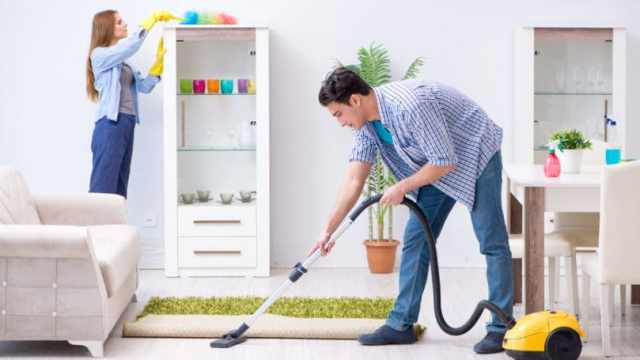 Family Cleaning House Vacuuming Dusting Husband Wife