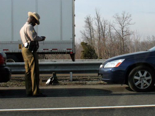 police writing speeding ticket