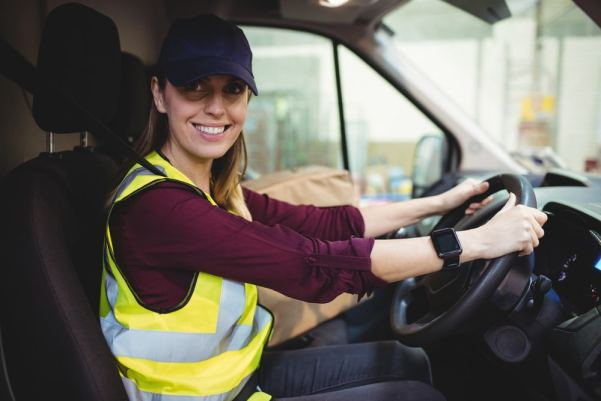 female courier driving a van
