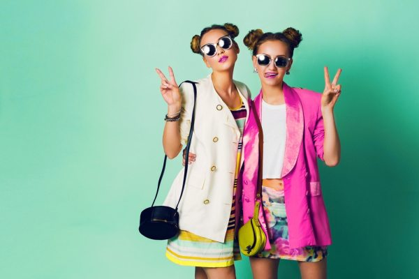 Teenage girls in fashionable clothing