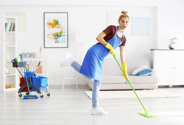 Woman cleaning energetically