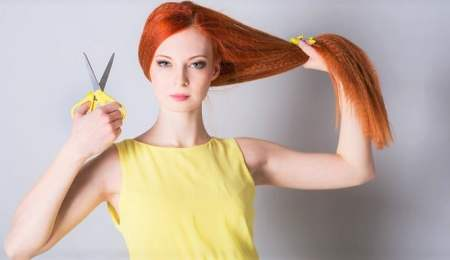 Red Head Woman with long hair and scissors