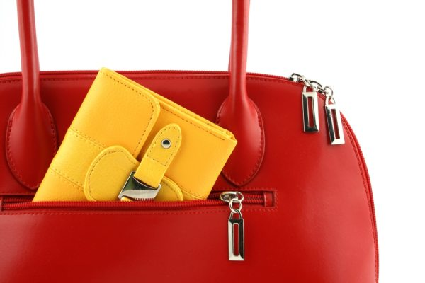 Red handbag with yellow purse in
