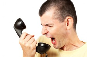 Man shouting at annoying cold caller on phone