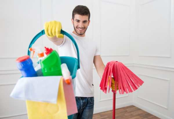 Man holding cleaning supploes
