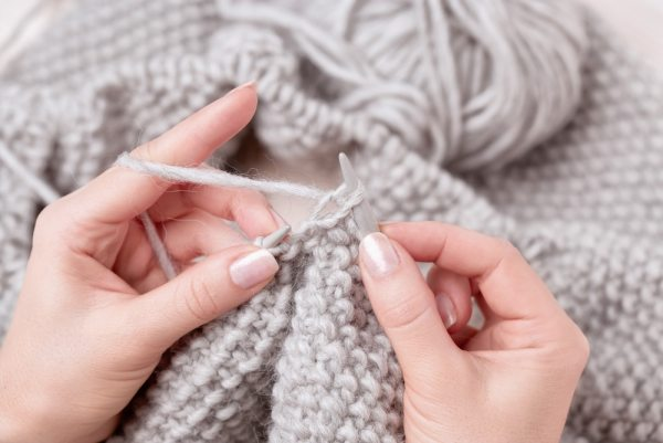 Womans hands knitting