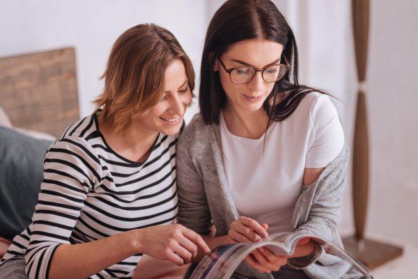 Two women reading magazine