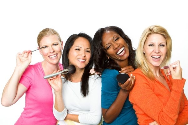 Women laughing and applying make-up
