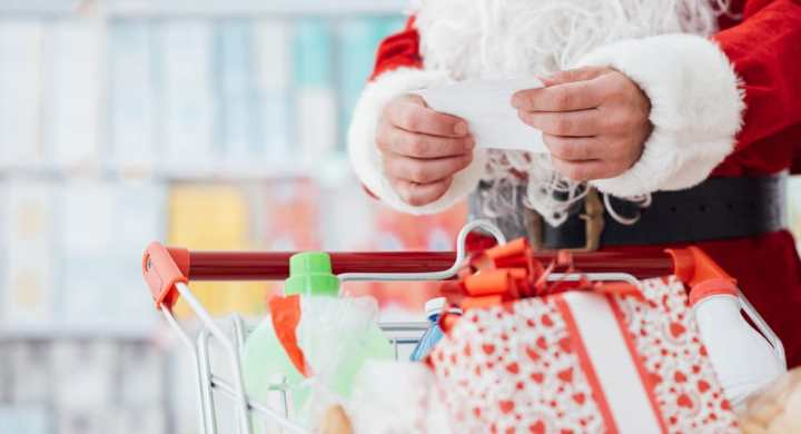 Santa checking list in supermarket