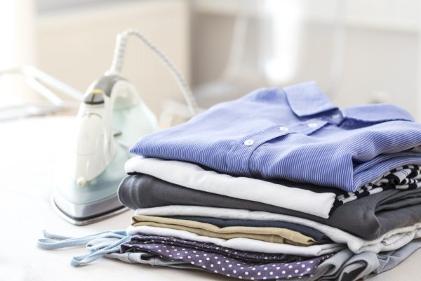 Folded clothes on ironing board