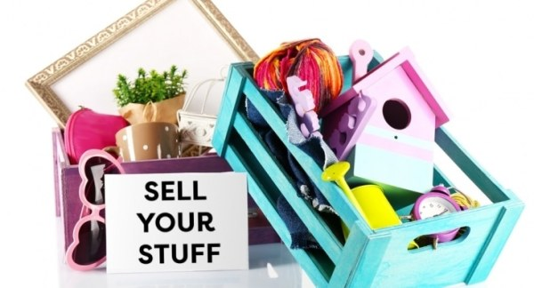 "Crates full of items and ""Stuff To Sell"" sign"