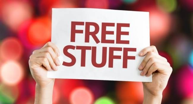 "Concept- hands holding sign reading ""Free Stuff"""
