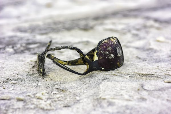 Broken sunglasses in the sand