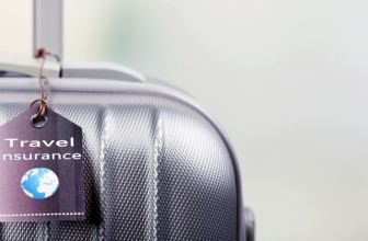 "Suitcase with label that reads ""Travel Insurance"""