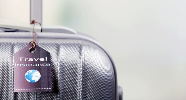"""Suitcase with label that reads """"Travel Insurance"""""""