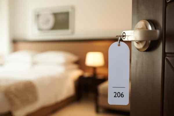 Hotel room through open door