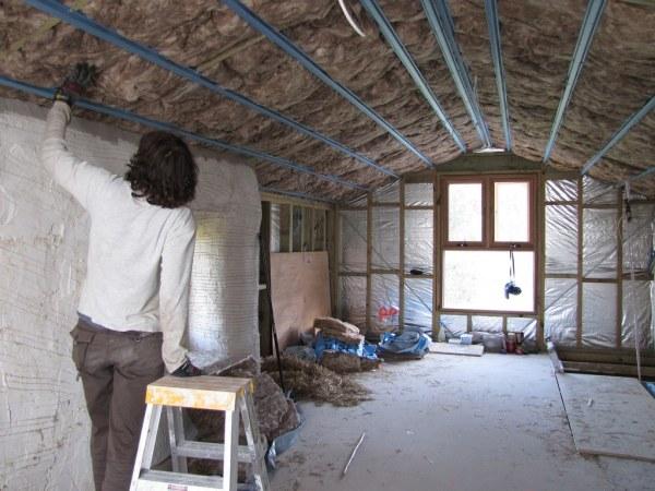Man installing home insulation