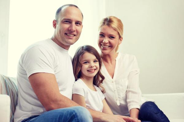Foster parents with little girl