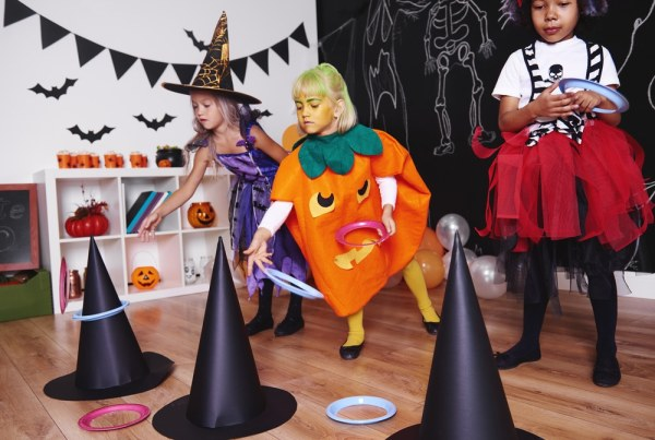 Children playing halloween ring toss game