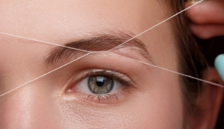 Woman having her eyebrows threaded