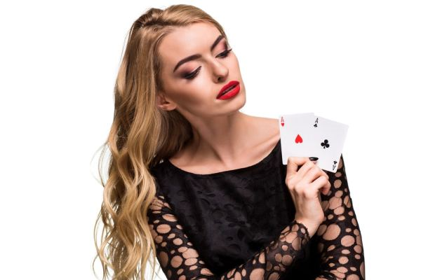 Female magician holding playing cards