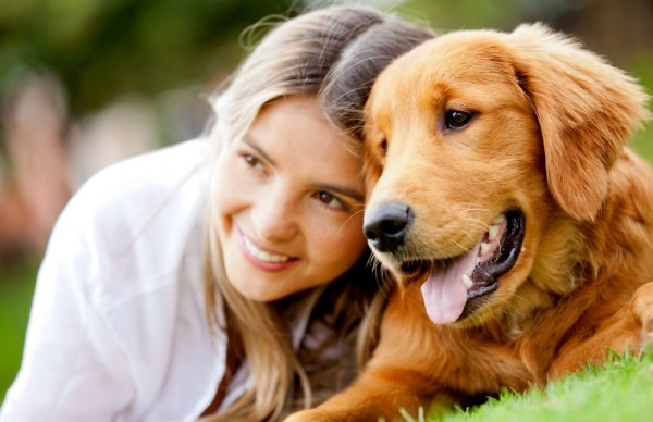 Woman with her golden retriever