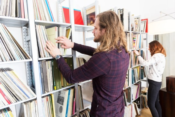 Couple searching for records to add to their collection