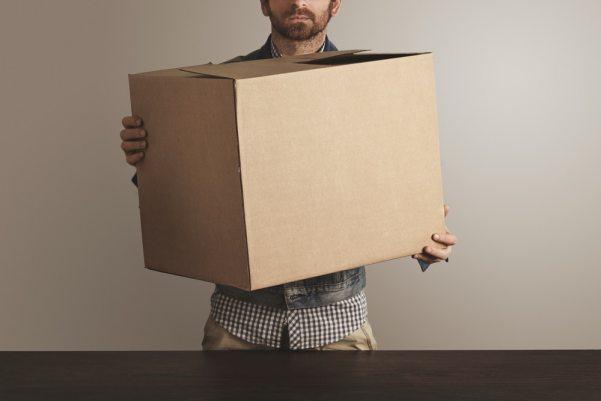 Man holding large cardboard box