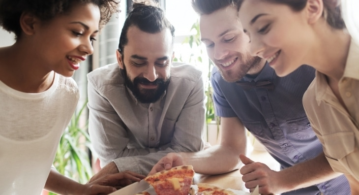 Students sharing a pizza