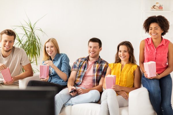 Group watching film at home