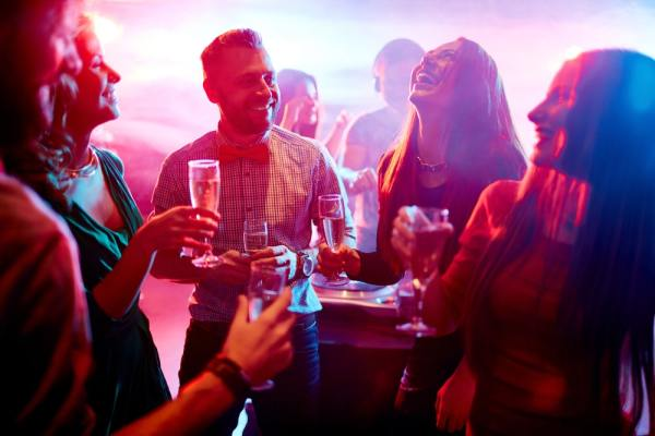 Group laughing and drinking in nightclub