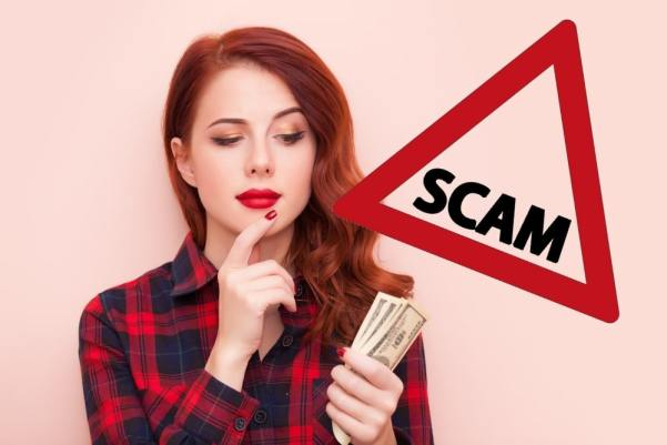 Woman looking at money in her hand quizzically and a scam warning sign laid over the top